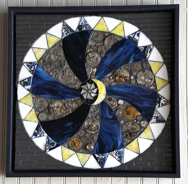 """In every journey there is a moment when you have to commit.  You must make a plan, pack up and decide it is time to leave; decide it's time to change.  This quilt block, for me, represents that moment.  It is layered with spiritual connections – the Carpenter's Wheel, referencing Jesus the carpenter and Ezekiel's wheel which ran on faith and grace.  We are told to """"steal away to Jesus"""", to find our own freedom, our own path."""