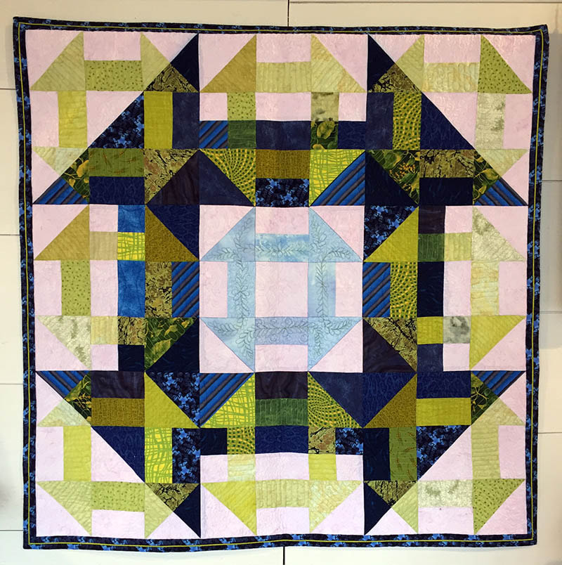 """At first glance we see the large image, then realize that all the parts of it are made by combining the parts of smaller images, simply by changing the """"value"""", or lightness/darkness of those pieces.  In the same way, the message behind the quilt pattern was hidden in plain sight.  So that only those who had the key could read the message."""