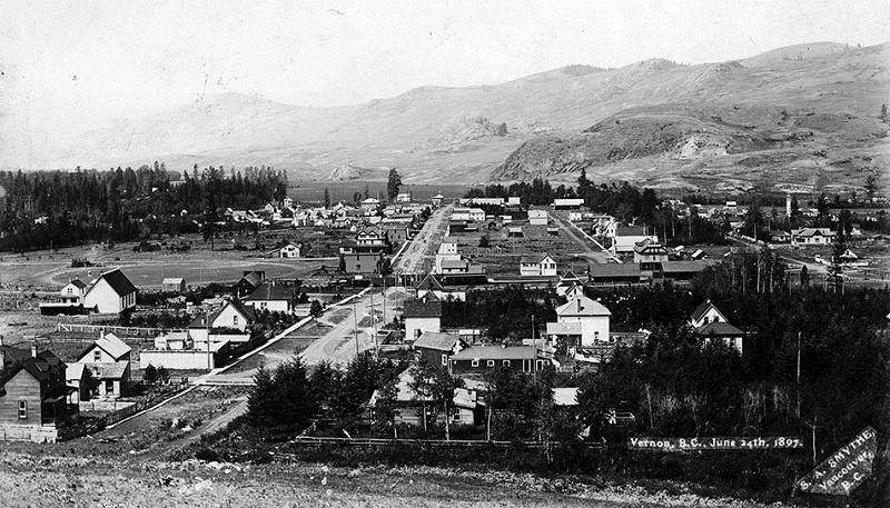 historic image of Greater Vernon - town and mountains in background