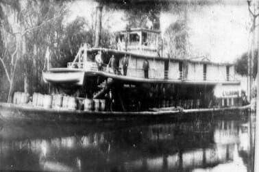boat rafting timber downriver