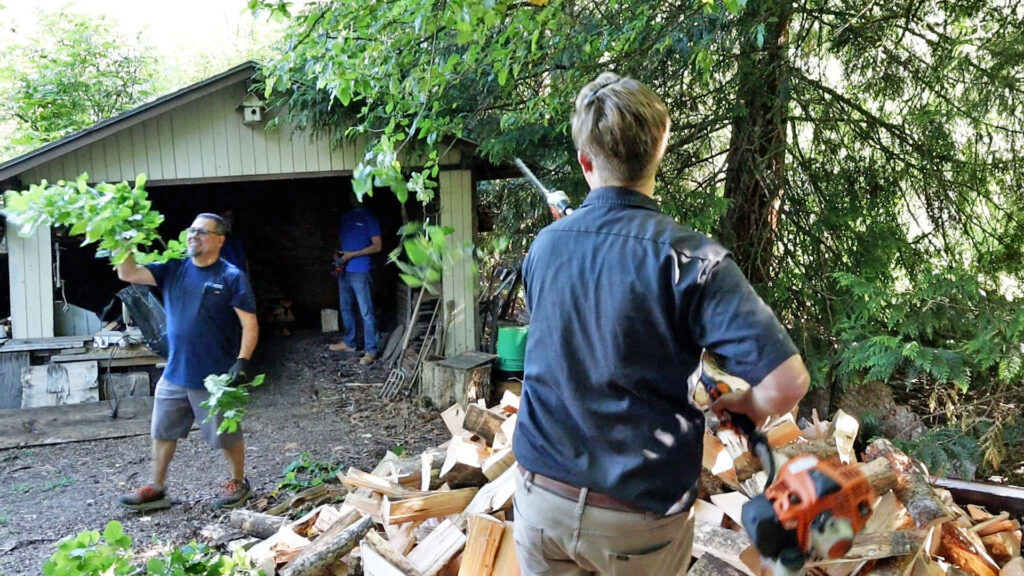 Volunteers did manual labor like clearing brush and stacking firewood.