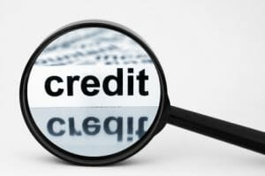 magnifying glass with the word credit