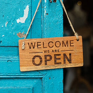 """""""welcome we are open"""" sign"""