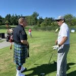 Garry with Bagpiper Delta Police