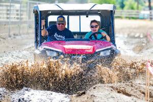 open air Honda splashing through mud