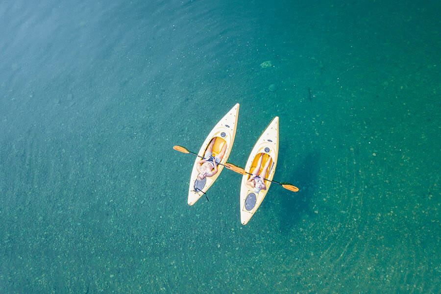 kayaks on clear water