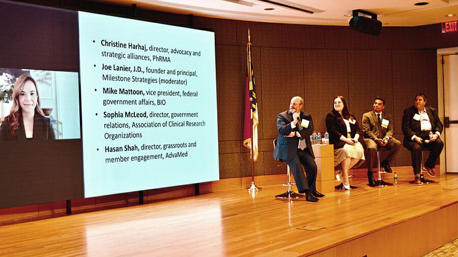 Christine Harhaj, PhRMA (on screen); Joe Lanier, Milestone Strategies; Sophia McLeod, ACRO; and Hasan Shah, AdvaMed; Mike Mattoon, BIO