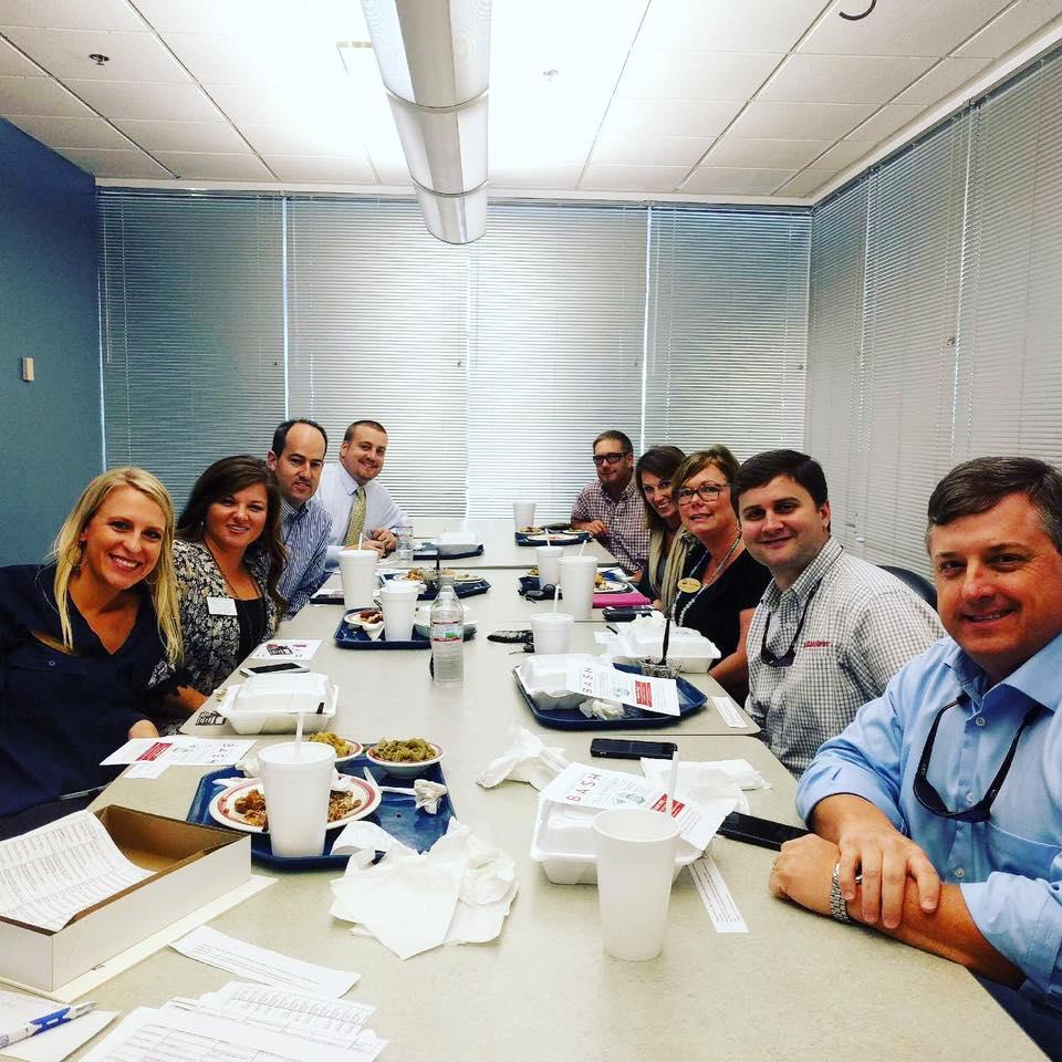 Group of Chamber Ambassadors at a table