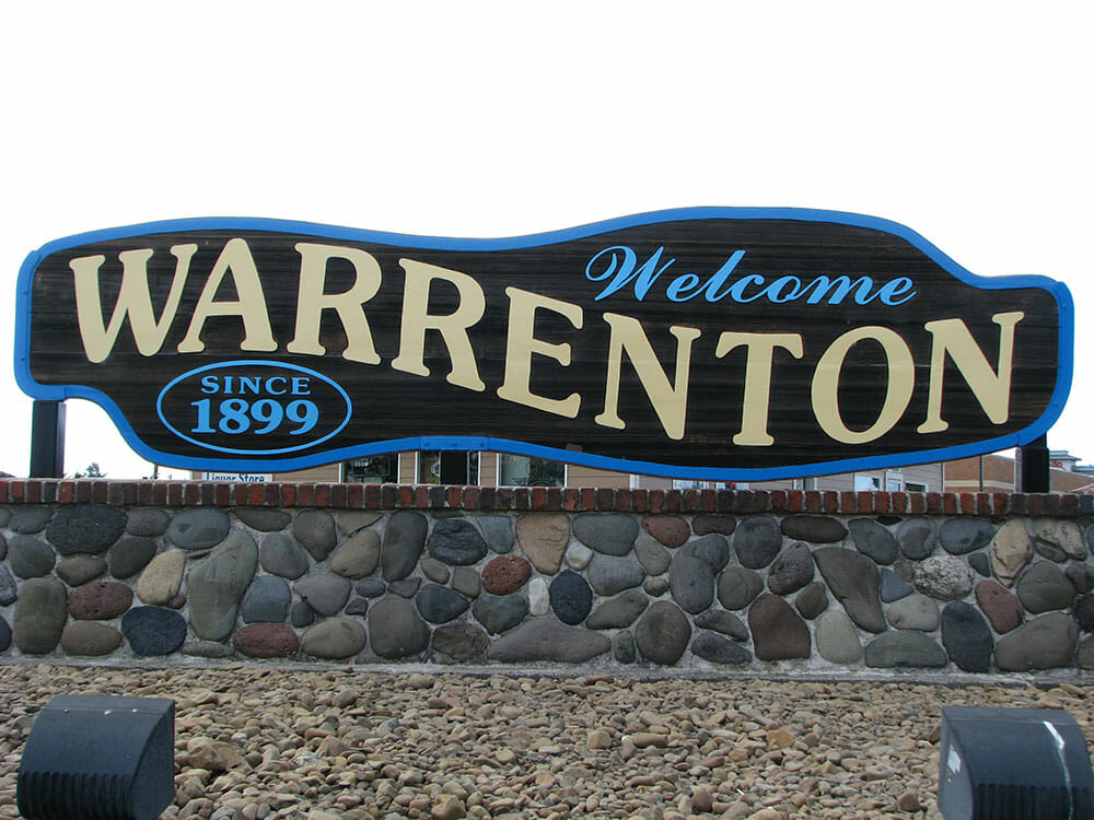 A sign welcoming people at the city limits of Warrenton, Oregon.