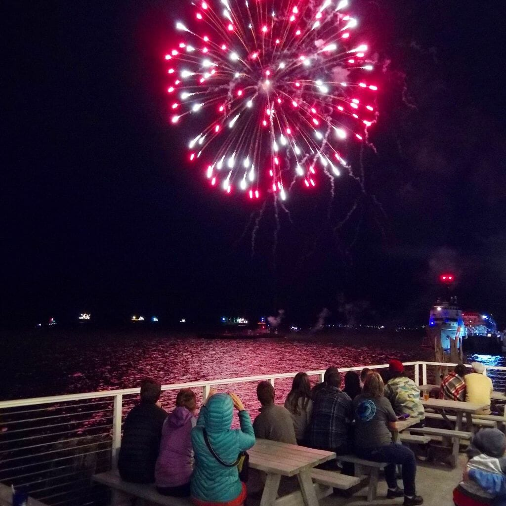 Spectators watch fireworks over the Columbia River in Astoria, Oregon.