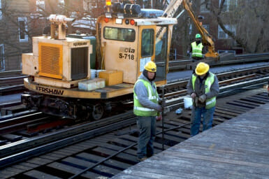 """A pair of CTA workers repair """"L"""" tracks"""
