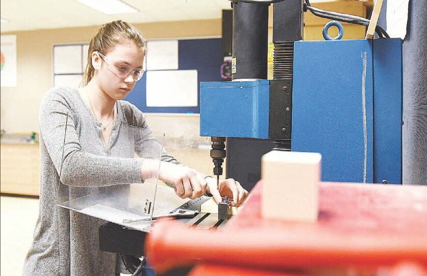 Samantha Cormier, a junior at Spaulding High School in Rochester, works in the engineering lab at the school's technology center. She was setting up a computer-controlled milling machine.