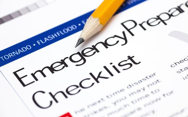 Emergency Preparedness Checklist with pencil. Close-up.