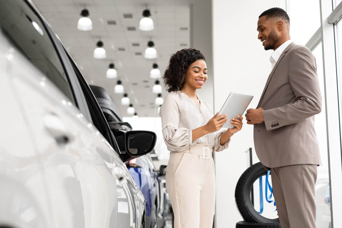 Woman looking at paperwork for buying a car