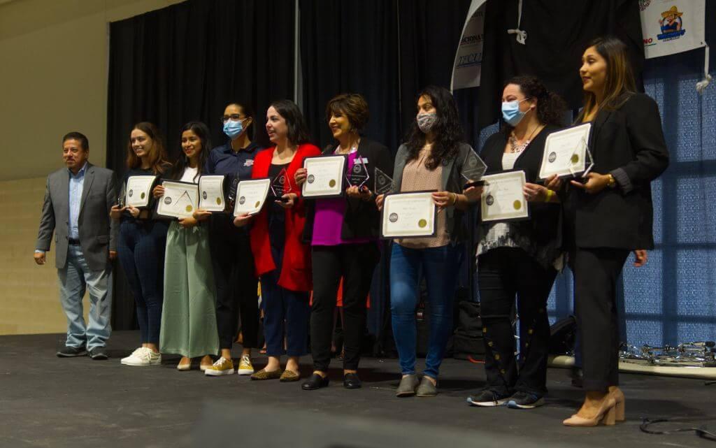 women receiving certificates and awards