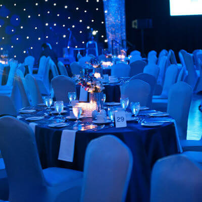 event tables in blue lighting