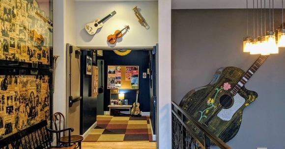 caffe lena guitars on wall