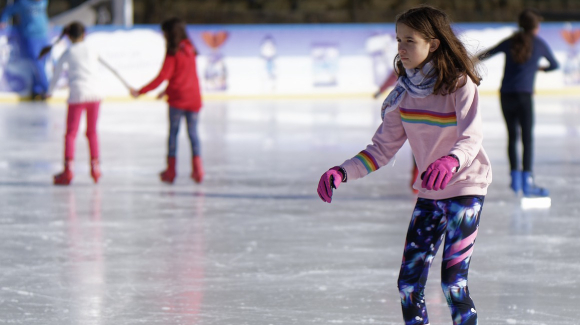 children skating on an outdoor rink