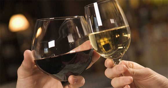 man and woman toasting wine glasses