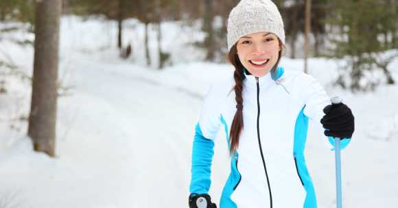 Young woman x-country skiing