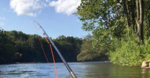 fishing pole at lakeside