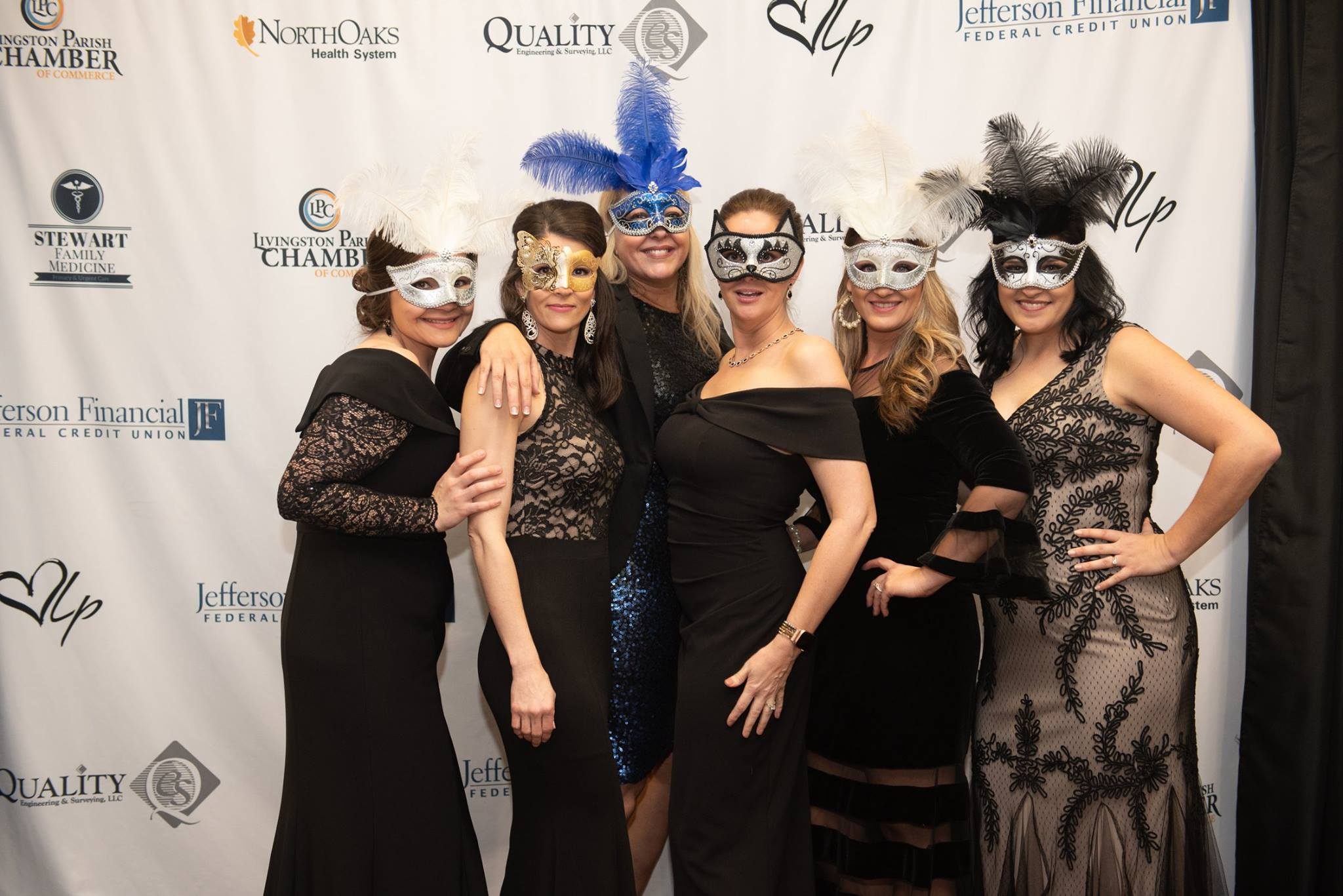 Women with masks at Gala