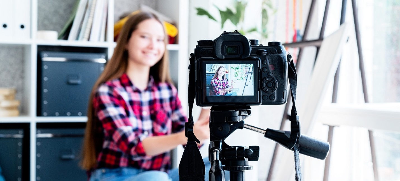 Smiling teenager girl blogger making a video for her blog on art