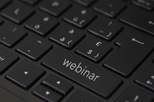 Leadership-Conducting Webinars - Keyboard with the word webinar on a key
