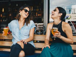 two women having cocktails at brewery