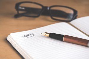 Pen lying on open notebook