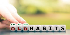 hand-turns-dice-and-changes-the-expression-old-habits-to-new-habits