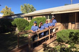 YLC Members build a ramp for HBF recipient