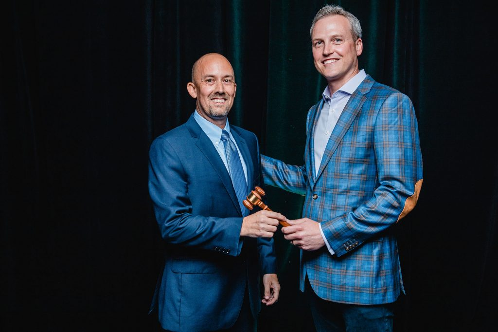 Previous Board Chair, Matthew Clark of Broadway Real Estate Services passing the gavel to new Board Chair, William T. Link, Jr. of Reed Mawhinney & Link, PLLC&