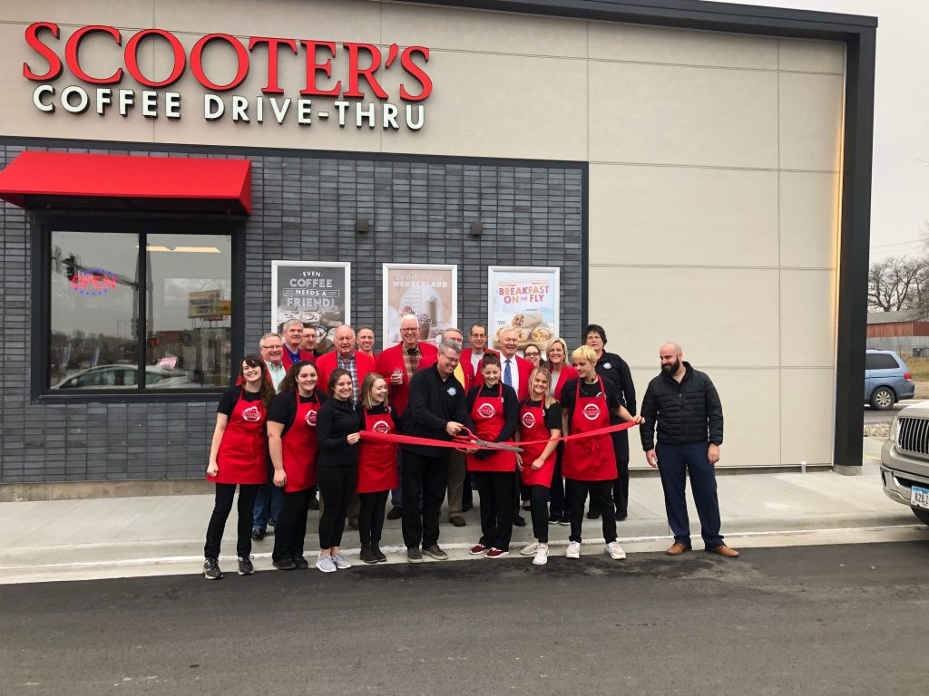 On December 13, Chamber Ambassadors and staff cut a ribbon to celebrate the Grand Opening at Scooter's Coffee (327 Story Street).