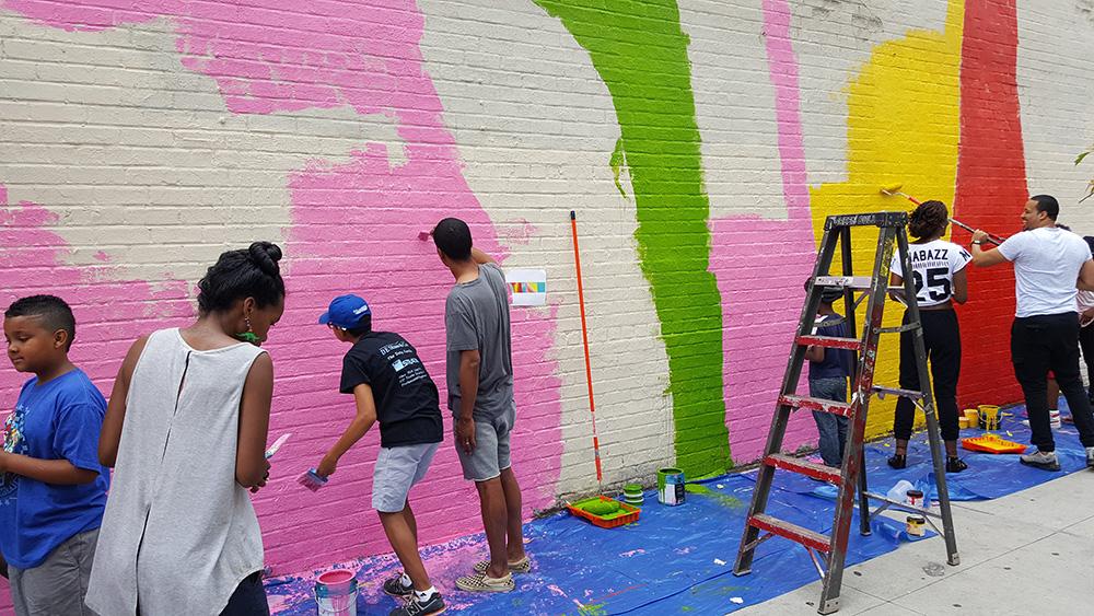 volunteers_paint_yuri_malcolm_x_mural_YnM13
