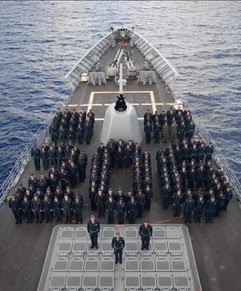 "Crew of USS San Jacinto form ""206"" to represent the number of days they were at sea."