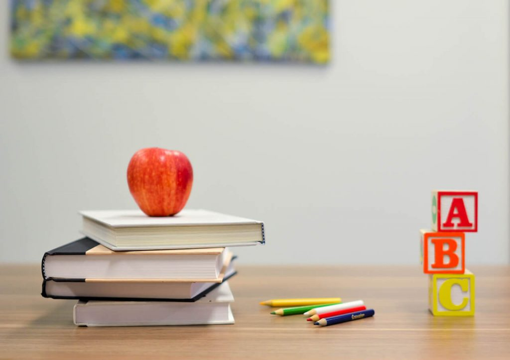 NC Governor Roy Cooper Extends Phase 2 | School books, picture courtesy Element 5 on Unsplash
