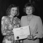 Charlotte Weiss accepts 1990 Best Student Paper Award from Toni Carbo Bearman (president)