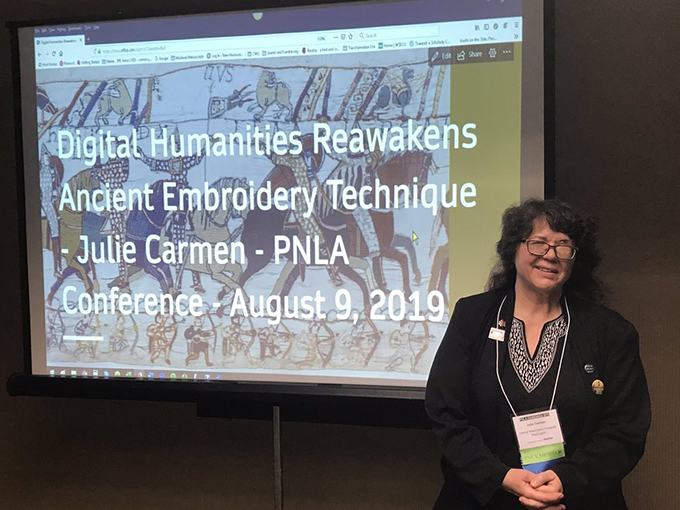Julie Carmen giving presentation at PNLA 2019 Conference.