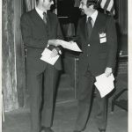 Walter J. Maytham, with Art Elias. The John Wiley representative is receiving the 1974 Best IS Book Award