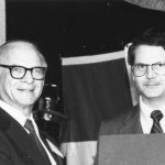 Andrew Aines receiving 1982 Award of Merit from Charles Davis