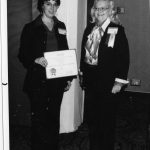 Barbara Laurence receiving SIG-of-the-Year Award from Joe Ann Clifton