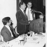 Gerald Salton (at podium). Jules Bergman, ABC News (seated) and Dale Baker. Salton is receiving 1975 Best IS Book Award