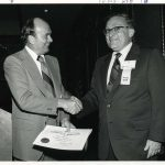 John Sherrod receiving Certificate of Appreciation from Herbert White (r) at ASIST '73