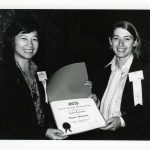 Ching-Chih Chen (Simmons) presenting Student Paper Award to Brigitt Huybrechts (student at University of Maryland), ASIS '79