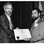 Michael Arbih receiving Best Information Science Book Award for 1973 from James E. Rush