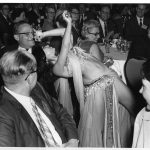 Herbert White under belly dancer's thumb