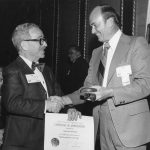 Si Newman receives Certificate of Appreciation from President John Sherrod