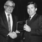 George E. Brown receiving award from Tom Hogan