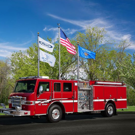 Fire truck in front of flags